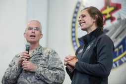 U.S. Air Force Gen. Paul J. Selva, Vice Chairman of the Joint Chiefs of Staff, introduces Katie Meili, U.S. Olympic swimmer, aboard the aircraft carrier USS George H. W. Bush (CVN 77)