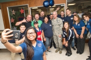 Selfie with USO Naples staff pose outside the USO Capodichino Lounge in Naples, Italy